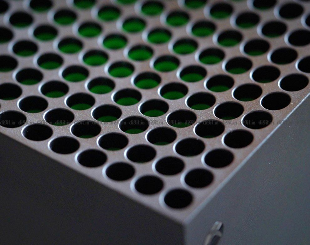 The Xbox Series X top vent has a hint of green.