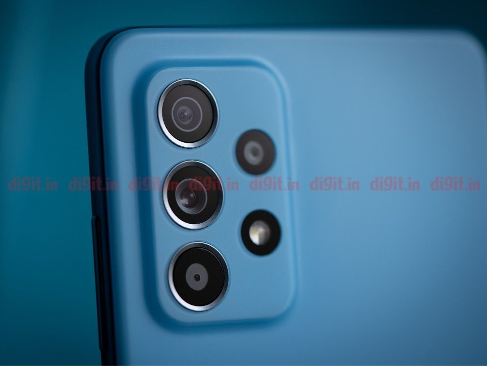The rectangular camera module on the Galaxy A52 is tucked away in the top-left corner and is slightly raised than the rest of the body.